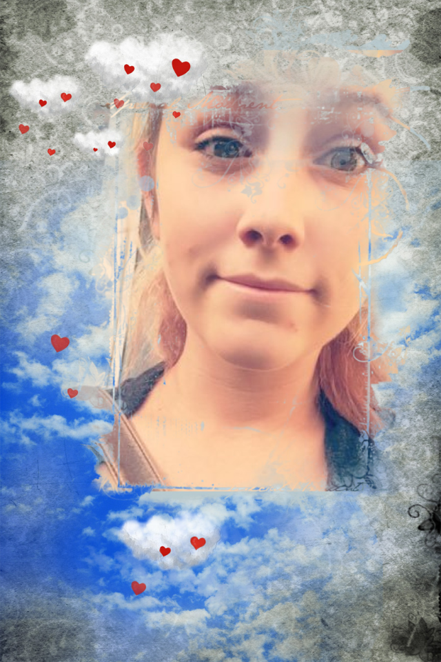 alexa in blue sky wh clouds red hearts